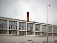 An abandoned factory in the old industrial area of Lisbon. This photograph is part of a body of work about Lisbon, feelings, affections and loneliness. Is about a city depressed by the crisis, but even so, tolerant and cosmopolitan. This part of Lisbon, near the river Tejo (Tagus), with his deep character, where local people meets foreigners and alternative ways of life mixes with shamefaced poverty, is sublime by its peculiar light.