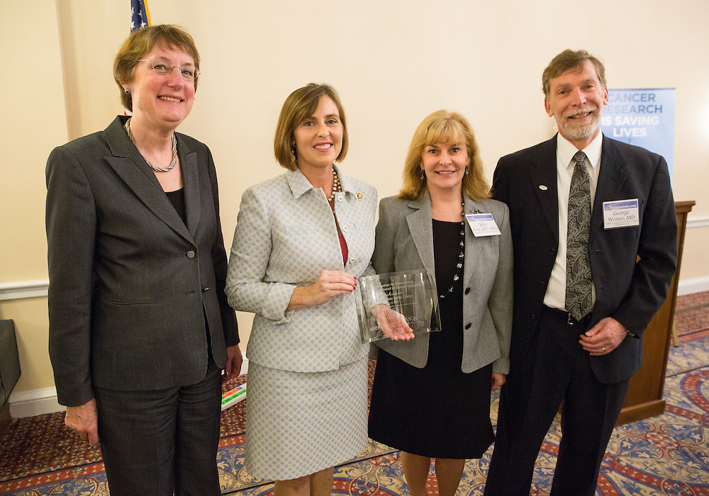 L to R: Nancy Davidson, MD, Rep. Kathy Castor (D-FL), Dr.Julie Vose, MD, MBA, FASCO, President of ASCO, and George Weiner, MD, during the Hill Day reception held at Rayburn House Office Building in Washington, DC, on Wednesday, May 11, 2016. The American Association for Cancer Research (AACR), the Association of American Cancer Institutes (AACI), and the American Society of Clinical Oncology (ASCO) honored U.S. Representatives Kathy Castor (D-Fla.) and Chuck Fleischmann (R-Tenn.) for their outstanding leadership on behalf of cancer research during the reception. (Alan Lessig/)