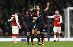 AC Milan's Hakan Calhanoglu (right) celebrates scoring his side's first goal of the game during the UEFA Europa League round of 16, second leg match at the Emirates Stadium, London.