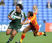 Reading, GREAT BRITAIN, Left,  Exiles, Seilala MAPUSUA attacking on the wing brushes aside David MARTYS, lunging tackle, during the Heineken, Quarter Final, Cup rugby match,  London Irish vs Perpignan, at the Madejski Stadium on Sat 05.04.2008 [Photo, Peter Spurrier/Intersport-images].....Watford, GREAT BRITAIN, during the Pool 4 Rd 5  Heineken Cup game Saracens vs Biarittz at Vicarage Road, Hert's  26/04/2007  [Photo, Peter Spurrier/Intersport-images].....