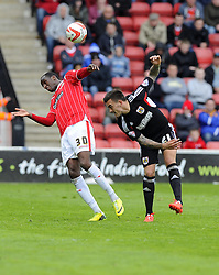 Bristol City's Marlon Pack battles for the high ball with Walsall's Michael Ngoo  - Photo mandatory by-line: Joe Meredith/JMP - Mobile: 07966 386802 12/04/2014 - SPORT - FOOTBALL - Walsall - Banks' Stadium - Walsall v Bristol City - Sky Bet League One