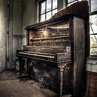 Broken down piano found in derelict school house in Arizona, USA