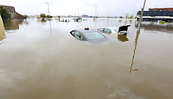 May 2, 2019 - Davenport, Iowa, U.S. - A baseball glove sits on the roof of one vehicle and the trunk is open of another as they sit in Mississippi River flood waters behind the Peterson Paper Co. Apartments in downtown Davenport Thursday. (Credit Image: © Kevin E. Schmidt/Quad-City Times via ZUMA Wire)
