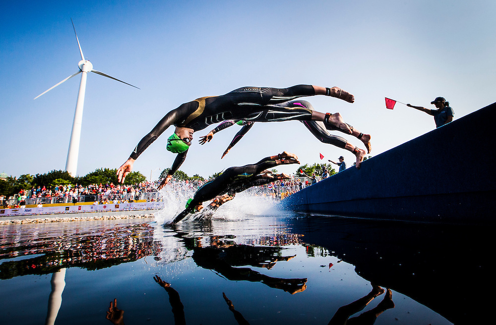 Mexico's Claudia Rivas dives in to the water with the rest of the racers to start the the Women's Triathlon at the Pan Am Games in Toronto, Thursday July 9, 2015.