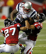 ATLANTA - AUGUST 19:  Running back Sammy Morris #34 of the New England Patriots is tackled by safety Matt Giordano #27 and safety Shann Schillinger #39 of the Atlanta Falcons during the preseason game against the at the Georgia Dome on August 19, 2010 in Atlanta, Georgia.  The Patriots beat the Falcons 28-10.  (Photo by Mike Zarrilli/Getty Images)