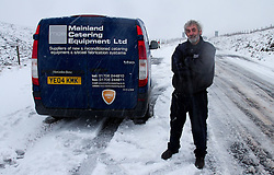 © Licensed to London News Pictures. 27/01/2012. Derbyshire, UK. Tom Duckworth of Mainland Catering Equipment Ltd halts in severe snow on the Snake Pass. Drivers struggle with the impact of a severe snowfall along Derbyshire's notorious Snake Pass Road. Photo credit : Joel Goodman/LNP