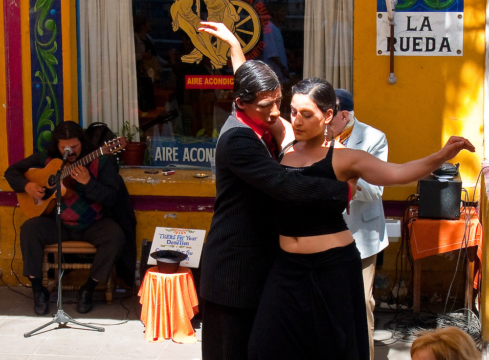 The tango is the National dance of Argentina. It is rightly considered one of the most sensual dances. La Boca, Buenos Aires, Argentina