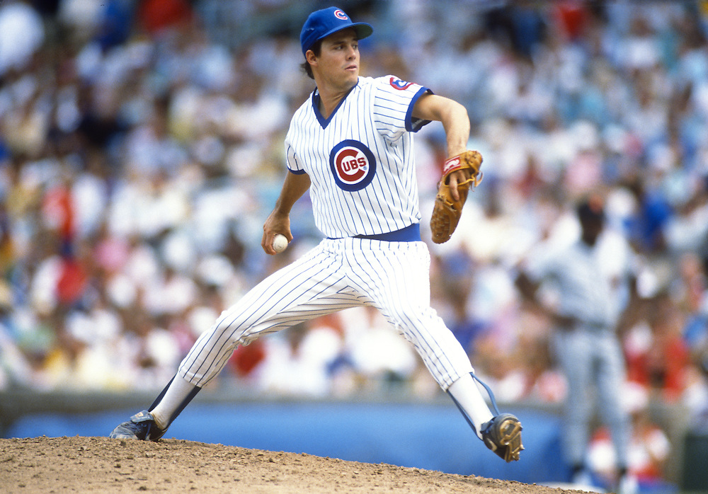 CHICAGO - CIRCA 1988:  Greg Maddux of the Chicago Cubs pitches during an MLB game at Wrigley Field in Chicago, Illinois.  Maddux played for the Cubs from 1986-1992. (Photo by Ron Vesely)