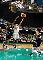 Virginia guard Sharnee Zoll (5) shoots a hook shot over Georgia Tech forward Janie Mitchell (21).  The #4 seed/#25 ranked Virginia Cavaliers women's basketball team defated the #5 seed Georgia Tech Yellow Jackets 52-43 in the quarterfinals of the 2008 ACC Women's Basketball Tournament at the Greensboro Coliseum in Greensboro, NC on March 7, 2008.