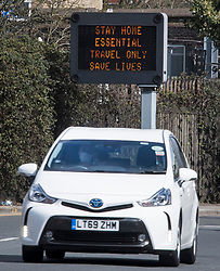 © Licensed to London News Pictures. 29/03/2020. London, UK. A road sign warning motorists against none essential travel during a lockdown to slow the spread of COVID-19. Members of the public have been told they can only leave their homes to exercise briefly once a day, and to go to shops for essentials when absolutely necessary, in an attempt to fight the spread of Coronavirus. Photo credit: Ben Cawthra/LNP