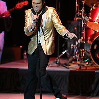 """Elvis Tribute Artist Michael Cullipher performs """"Mean Woman Blues"""", during the Ultimate Elvis Tribute Artist Competition Finals Saturday night at the BancorpSouth Arena in Tupelo."""