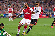 July 15 2017: Arsenal player Alexandre Lacazette (9) almost gets the ball around Western Sydney Wanderers goalkeeper Vedran JANJETOVIC (20) at the International soccer match between English Premier League giants Arsenal and A-League team Western Sydney Wanderers at ANZ Stadium in Sydney.