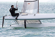 Ray Davies (NZL273) rounds the top mark in race three of the A Class World championships regatta being sailed at Takapuna in Auckland. 12/2/2014