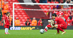 LIVERPOOL, ENGLAND - Sunday, May 11, 2014: Liverpool's Luis Suarez plays with his daughter Delfina and son Benjamin after the Premiership match at Anfield. (Pic by David Rawcliffe/Propaganda)