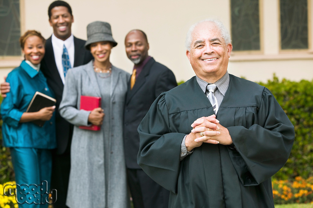 Smiling Preacher with Congregation