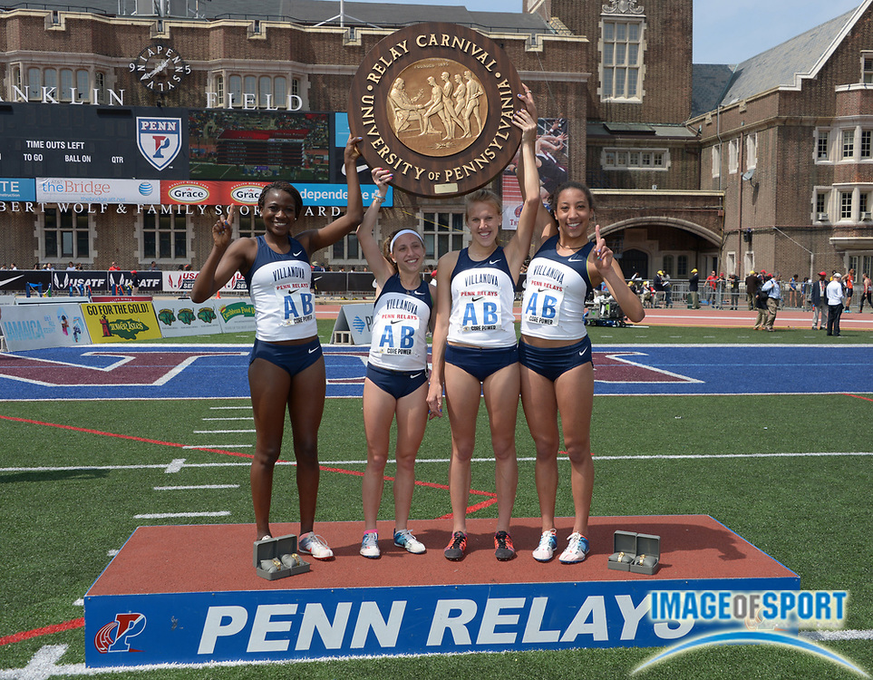 Apr 25, 2014; Philadelphia, PA, USA; Members of the Villanova womens 4 x 1,500m relay pose with the pinwheel after winning the Championship of America race in 17:16.52 in the 120th Penn Relays at Franklin Field. From left: Nicky Akande and Emily Lipari and Stephanie Schappert and Angel Piccirillo.