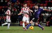 Cheltenham's Kevin Stewart and Morecambe's Alex Kenyon during the Sky Bet League 2 match between Cheltenham Town and Morecambe at Whaddon Road, Cheltenham, England on 16 January 2015. Photo by Alan Franklin.