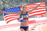 Emma Coburn (USA) poses with United States flag and New Balance spikes after placing second in the women's steeplechase in 9:02.35during the IAAF World Athletics Championships, Monday, Sept. 30, 2010, in Doha, Qatar. (Claus Andersen/Image of Sport)