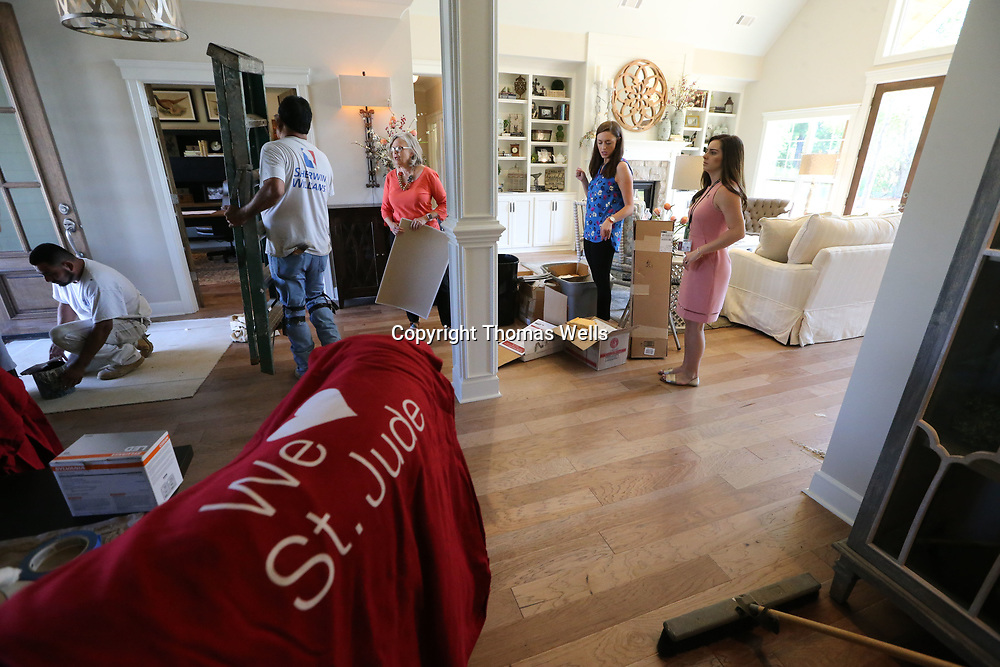 Painters and designers work to finish the interior of the St. Jude Dream Home on Rowan Oak in Tupelo.