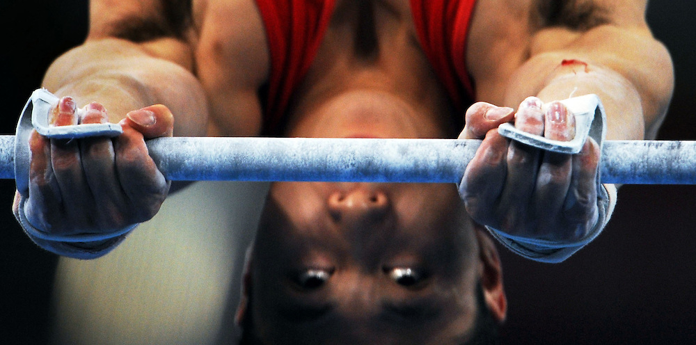 2008 OLYMPIC GAMES  - MEN'S TEAM GYMNASTICS  - 081208 - Chinese gymnast Xiaopeng Liperforms his turn on the horizontal bar during China's gold medal performance in the men's team competition. Li scored 15.75 on the apparatus and China went on to take the gold medal at the Olympic Games in Beijing, China.