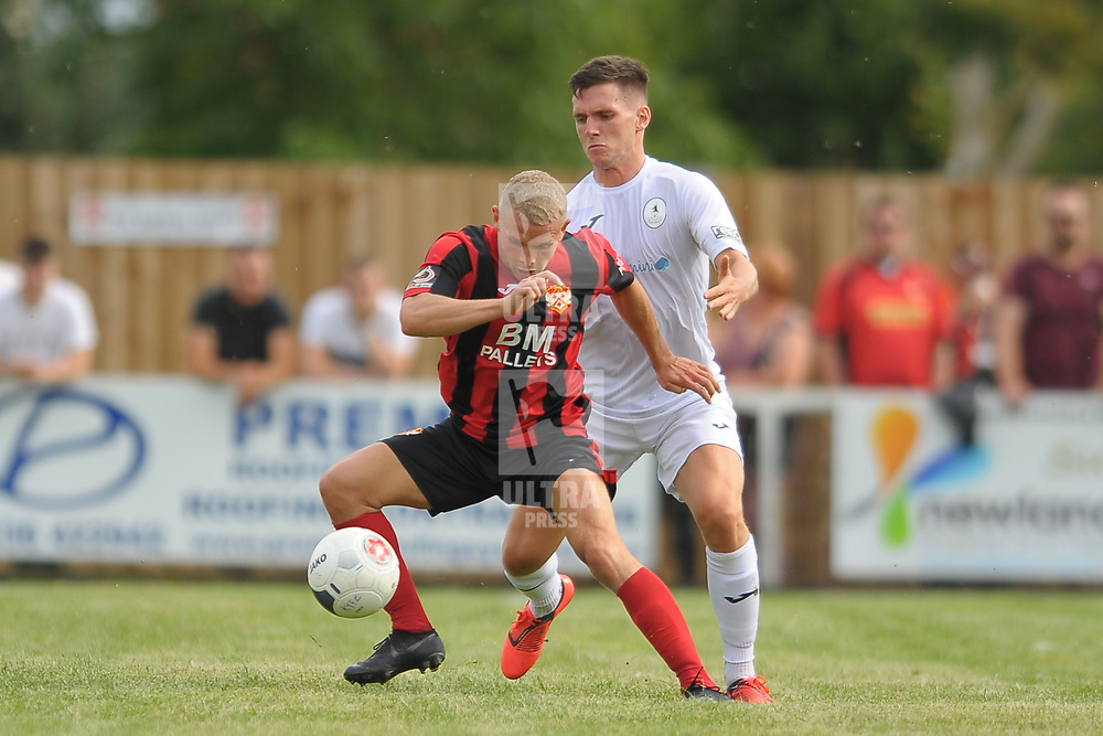 TELFORD COPYRIGHT MIKE SHERIDAN Ross White battles for the ball during the National League North fixture between Kettering Town and AFC Telford United at Latimer Park on Saturday, August 3, 2019<br /> <br /> Picture credit: Mike Sheridan<br /> <br /> MS201920-005