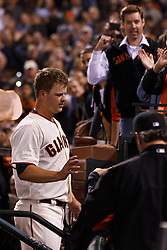 SAN FRANCISCO, CA - JUNE 13: Matt Cain #18 of the San Francisco Giants returns to the dugout after the game against the Houston Astros  at AT&T Park on June 13, 2012 in San Francisco, California. Cain pitched a perfect game as the San Francisco Giants defeated the Houston Astros 10-0. (Photo by Jason O. Watson/Getty Images) *** Local Caption *** Matt Cain