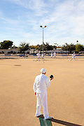 "Jerry Hobbs, 82, lawn bowls outside of the Bell Recreation Center in Sun City, Arizona December 8, 2010. The lawn bowling club is one of more than 120 clubs in the city of active retirees..""This is why we worked 50 years,"" lawn bowler Norm Dickson said after bowling his ball. ""...in the cold,"" his teammate Myron Myers chimed in...2010 marks the 50th anniversary of Sun City, America's first retirement city that remains the largest today with more than 40,000 residents 55 and older."