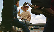 05 AUGUST 2000 - WILLIAMS, AZ:  T.J. Dolarhyde (CENTER) talks to his friends before competing at the 22nd Annual Cowpunchers' Reunion Rodeo in Williams, Arizona, Aug 5.  The Cowpunchers' Reunion Rodeo is held for working cowboys from the ranches in Arizona and the region. PHOTO BY JACK KURTZ