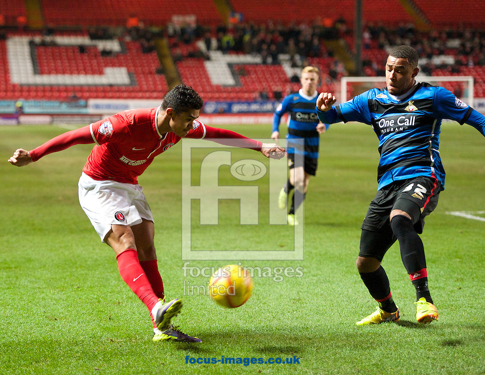 Picture by Alan Stanford/Focus Images Ltd +44 7915 056117<br /> 26/11/2013<br /> Cameron Stewart of Charlton Athletic gets his cross past Reece Wabara of Doncaster Rovers during the Sky Bet Championship match at The Valley, London.