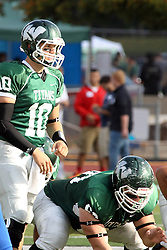 12 October 2013:  Rob Gallik under center Naill Mulcahy during an NCAA division 3 football game between the North Park vikings and the Illinois Wesleyan Titans in Tucci Stadium on Wilder Field, Bloomington IL