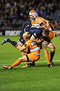 Tian Schoeman tackles James Johnstone during the Guinness Pro 14 2018_19 match between Edinburgh Rugby and Toyota Cheetahs at BT Murrayfield Stadium, Edinburgh, Scotland on 5 October 2018.