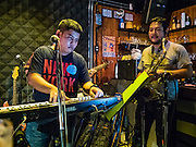 28 JANUARY 2016 - BANGKOK, THAILAND:   SoulBar, a popular bar on Chareon Krung Road in the Chinatown section of Bangkok, has live music every night. This is the local band NRG performing.       PHOTO BY JACK KURTZ