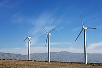 Three wind turbines in desert