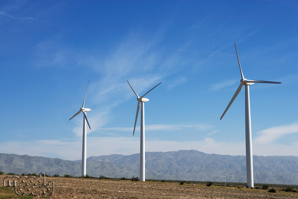 Three wind turbines in desert