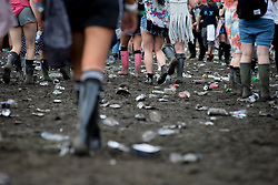 © Licensed to London News Pictures . 08/06/2014 . Heaton Park , Manchester , UK . Mud and rubbish on the ground in front of the Main Stage . The Parklife music festival in Heaton Park Manchester as the sun comes out . Photo credit : Joel Goodman/LNP