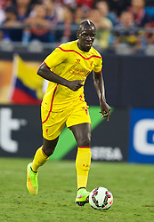 CHARLOTTE, USA - Saturday, August 2, 2014: Liverpool's Mamadou Sakho in action against AC Milan during the International Champions Cup Group B match at the Bank of America Stadium on day thirteen of the club's USA Tour. (Pic by David Rawcliffe/Propaganda)
