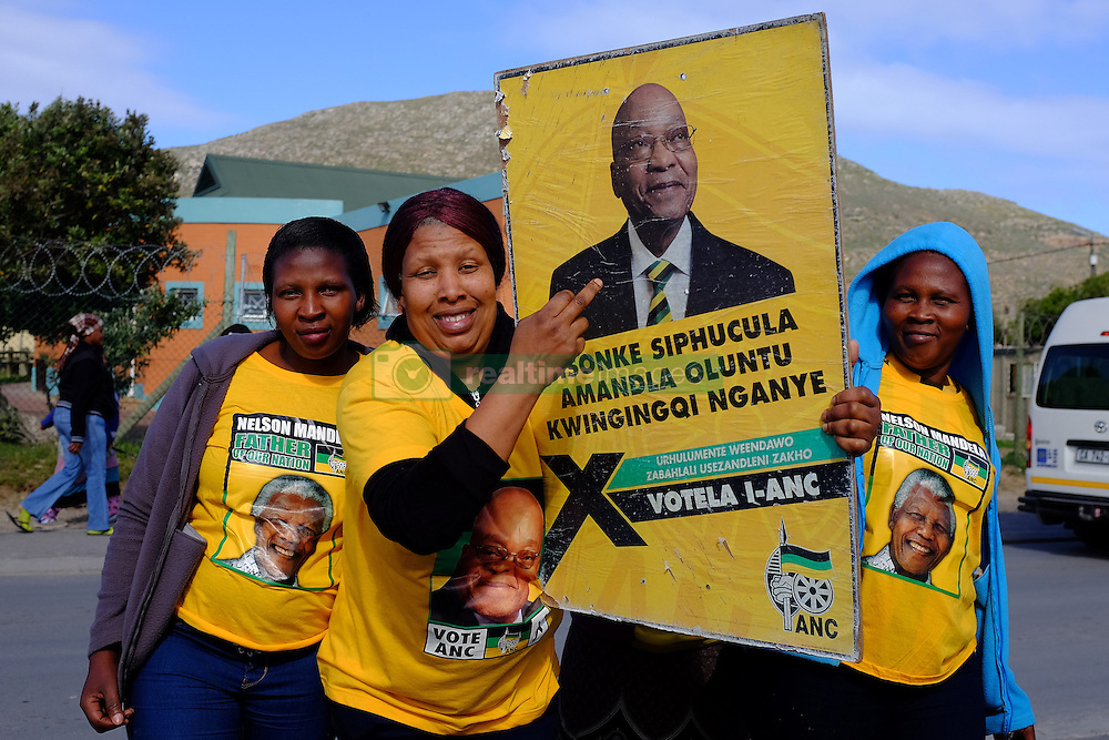 A supporter of the ANC points to a poster of the leader of the party, president Jacob Zuma in Masiphumelele near Fish Hoek, Cape Town during the 2016 local government elections held across South Africa on the 3rd August 2016<br /> <br /> Photo by - Ron Gaunt / RealTime Images