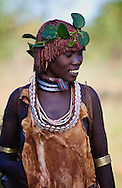 Hamar are known for practice of body adornment and roll their locks with fat and red ochre (assile) and than twist them into crimson-colored dreads called Goscha, a style thet men find attractive, Hamar women are known for their beauty..Dimeka, Omo Valley, Ethiopia, 2010