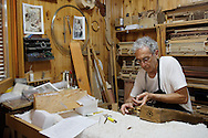 10/08/2016. Luthier Carlos Paniagua works on a Psaltery in a workshop on August 10, 2016 in Pelayos de la Presa, Madrid province, Spain. The Collegiate of Santa María la Mayor is a Romanesque architecture church built during the 12th and 13th centuries. Recents restorations of the Church discovered many details on its sculptures, and luthiers found the opportunity of recovering and to reproduce instruments showing on its North gate. (© Pablo Blazquez)