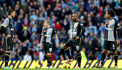11.11.2012, Etihad Stadion, Manchester, ENG, Premier League, Manchester City vs Tottenham Hotspur, 11. Runde, im Bild Tottenham Hotspur's Jermain Defoe, Clint Dempsey and Tom Huddlestone look dejected as Manchester City score the winning 2-1 goal during the Premiership match during the English Premier League 11th round match between Manchester City and Tottenham Hotspur at the Etihad Stadium, Manchester, Great Britain on 2012/11/11. EXPA Pictures © 2012, PhotoCredit: EXPA/ Propagandaphoto/ David Rawcliffe..***** ATTENTION - OUT OF ENG, GBR, UK *****