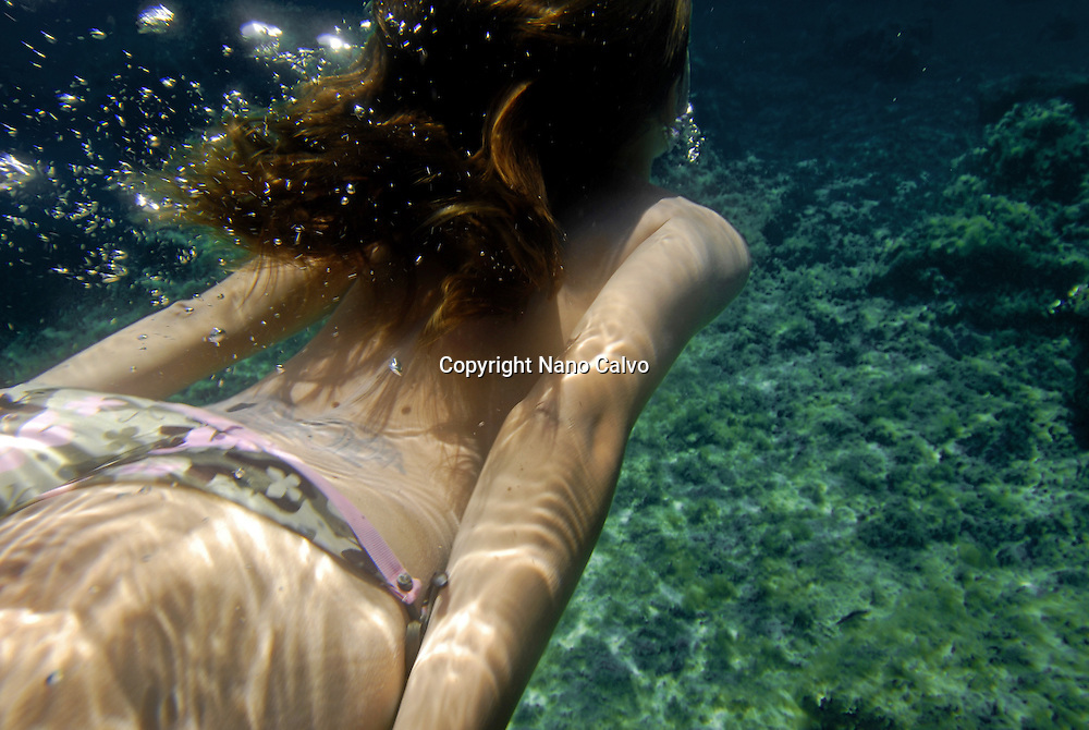 Young attractive woman underwater in Ibiza