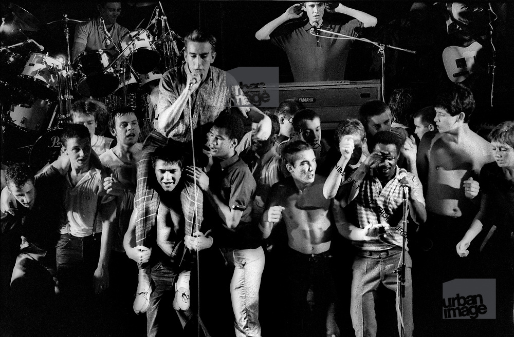 Specials concert in Brighton. Stage invasion brings the concert to a climax.