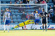 6th October 2018, Dens Park, Dundee, Scotland; Ladbrokes Premiership football, Dundee versus Kilmarnock; Dundee goalkeeper Elliott Parish saves Greg Stewart of Kilmarnock's penalty
