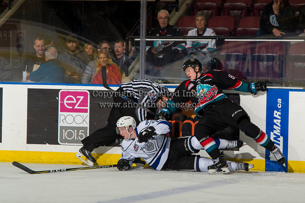 KELOWNA, CANADA - NOVEMBER 23:  The linesman ducks down to avoid a collision between Jack Cowell #8 of the Kelowna Rockets and Scott Walford #7 of the Victoria Royals during first period on November 23, 2018 at Prospera Place in Kelowna, British Columbia, Canada.  (Photo by Marissa Baecker/Shoot the Breeze)
