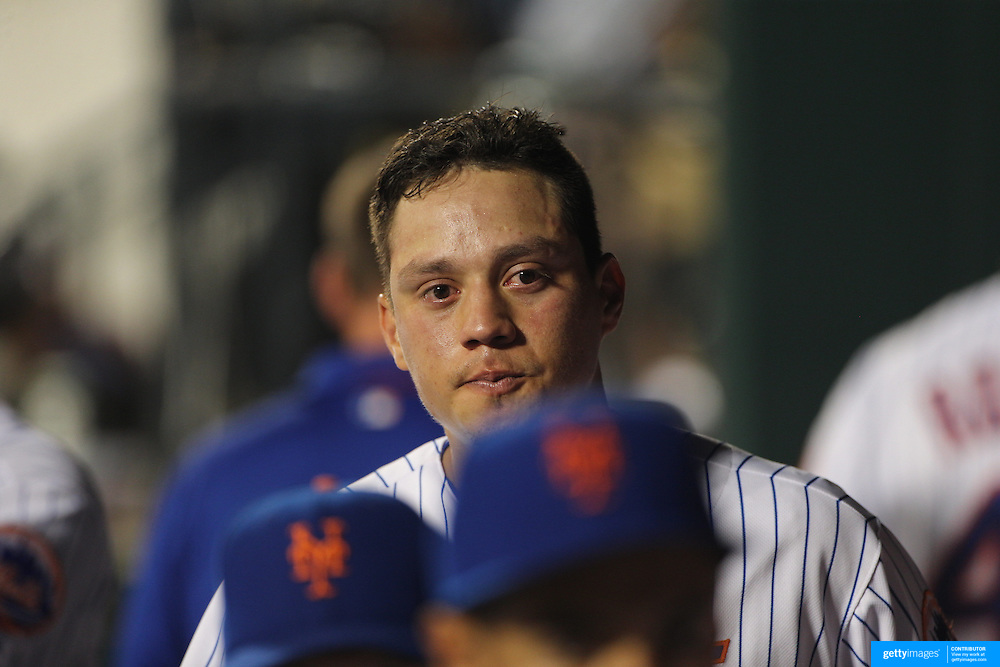 Wilmer Flores, New York Mets, in tears in the dugout  after learning he had been traded to the Milwaukee Brewers during the game. The trade subsequently fell through. New York Mets Vs San Diego Padres MLB regular season baseball game at Citi Field, Queens, New York. USA. 29th July 2015. Photo Tim Clayton