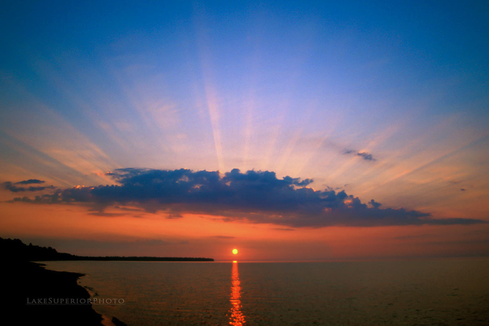 Rays of light, summer solstice sunset, Lake Superior