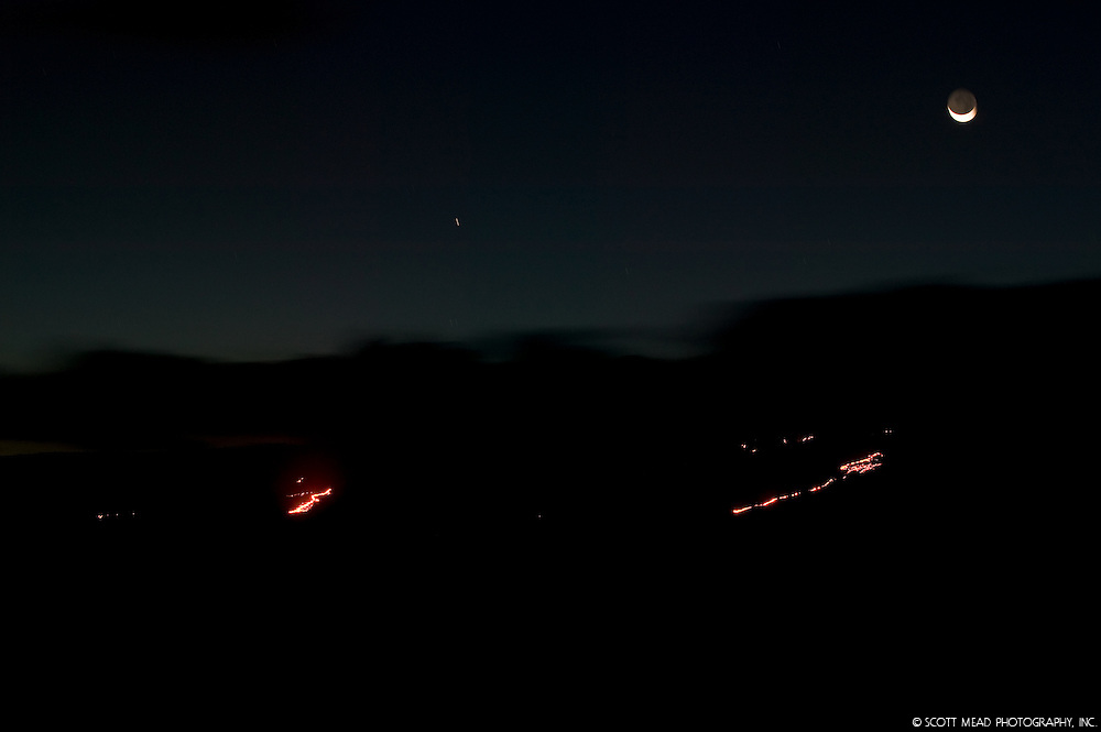 Image of crescent moon and shooting star over molten lava flow, from Kilauea, Volcano National Park, Big Island, Hawaii