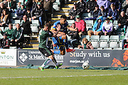 Lyle Taylor forward for AFC Wimbledon (33) battles Plymouth Argyle defender Peter Hartley (6) during the Sky Bet League 2 match between Plymouth Argyle and AFC Wimbledon at Home Park, Plymouth, England on 9 April 2016. Photo by Stuart Butcher.