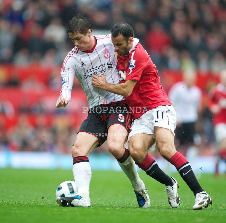 MANCHESTER, ENGLAND - Sunday, September 19, 2010: Liverpool's Fernando Torres and Manchester United's Ryan Giggs during the Premiership match at Old Trafford. (Photo by David Rawcliffe/Propaganda)