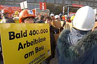 07 NOV 2002, BERLIN/GERMANY:<br /> Demonstraten mit Schildern, Demonstration gegen die Kuerzung der Eigenheimzulage, am Startpunkt Alexanderplatz<br /> IMAGE: 20021107-01-002<br /> KEYWORDS: Demo, Bau, Baugewerbe, Kürzung, Demostrant, demonstrator, Subventionen
